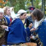 Ģērbjam un stāstam  Explaining and helping  visitors to try on costumes
